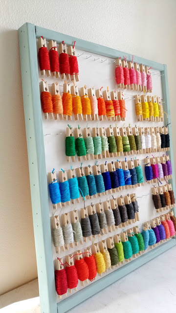 DIY Embroidery Floss Organizer using Clothespins featured by top US craft blog, Ameroonie Designs: image of  organize embroidery floss with clothespins