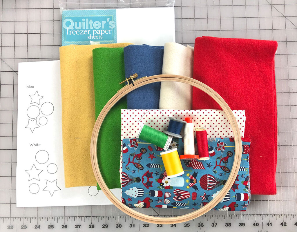 wool applique supplies- woven wool, thread, embroidery hoop, fabric, freezer paper