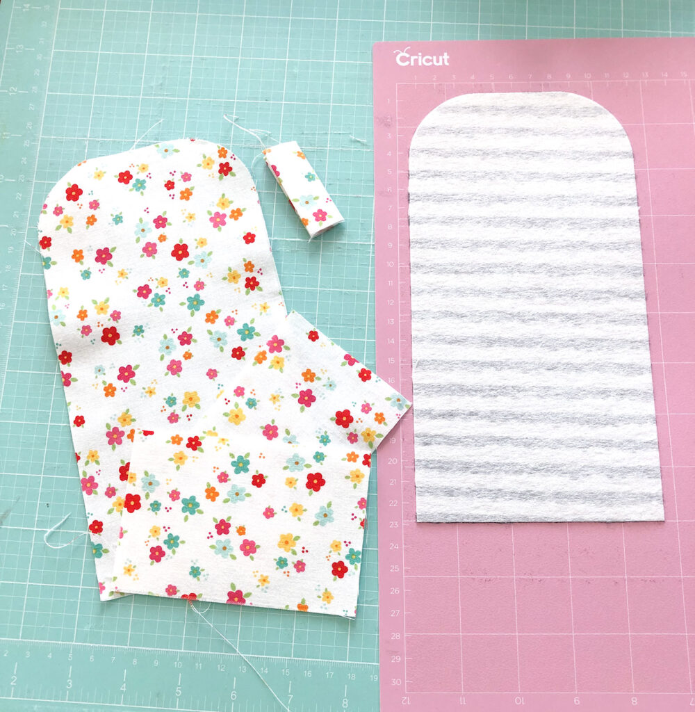 cutting fabric with the Cricut Maker, cotton fabric with and without medium weight fusible interfacing for a lunch money pouch.