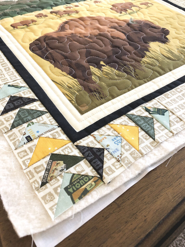 Flying Geese blocks in the Mini quilte border.