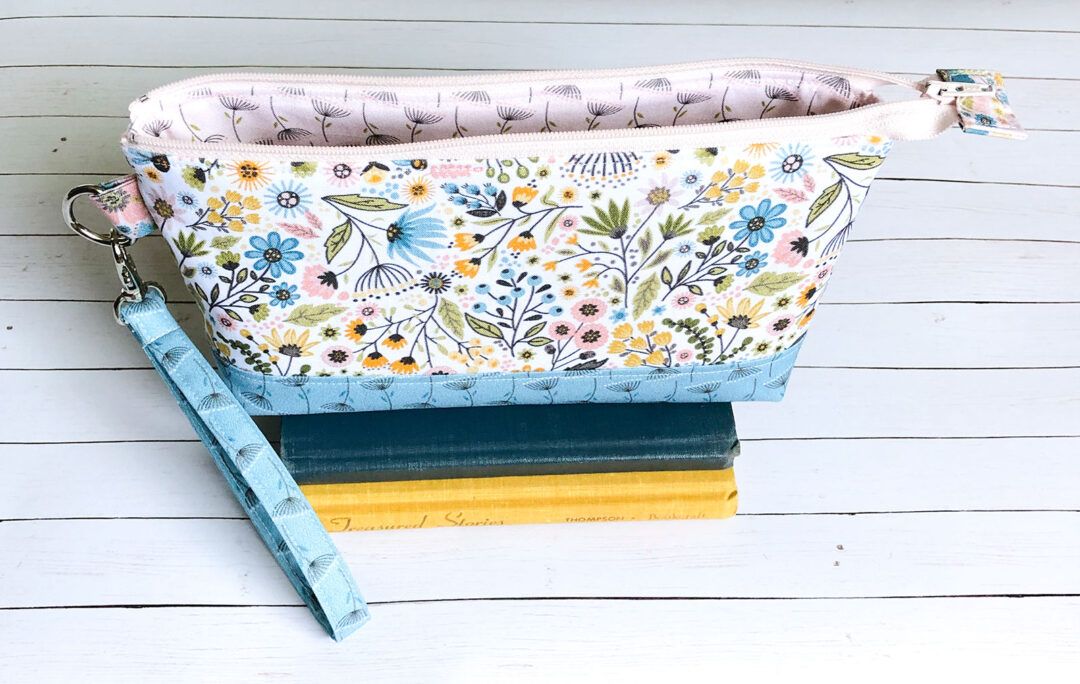 A zipper pouch sewn up with Wanderings fabric by Poppie Cotton
