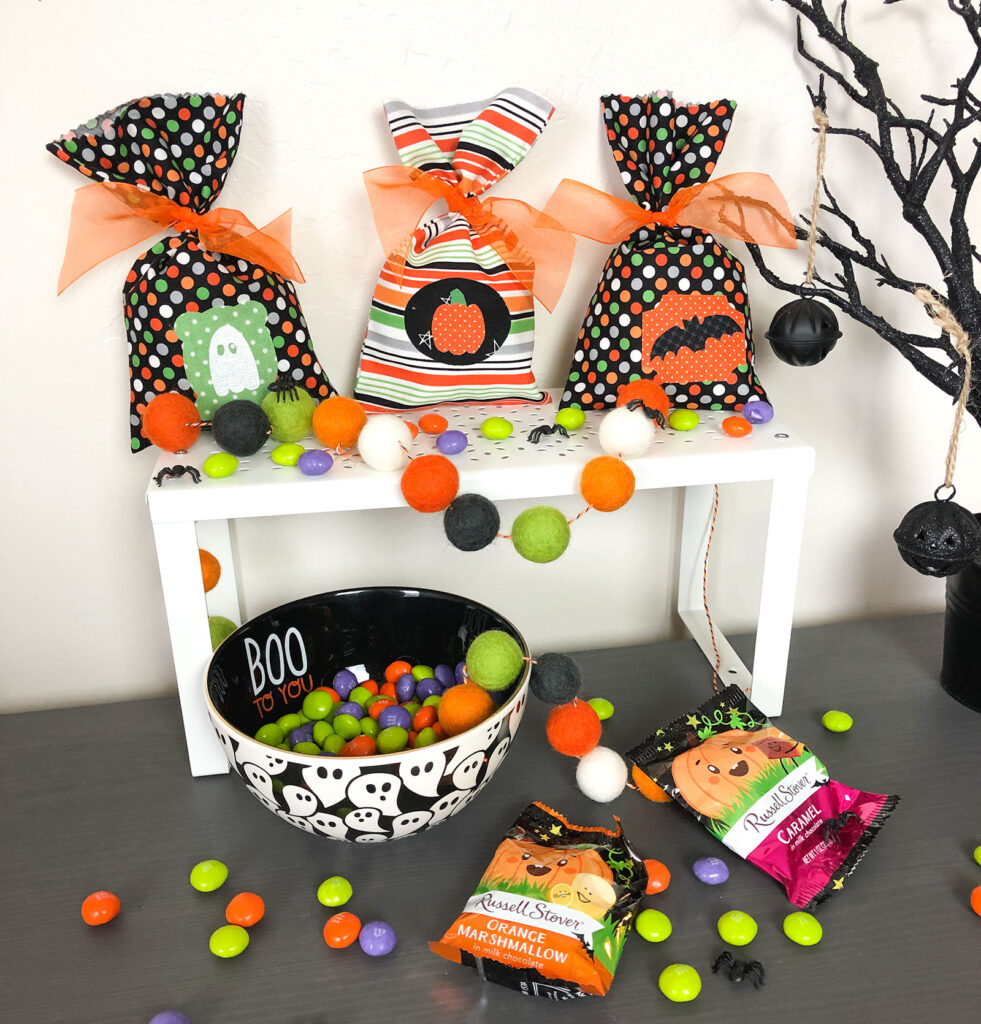Fill treat bags with candy or prizes and tie shut with ribbon.