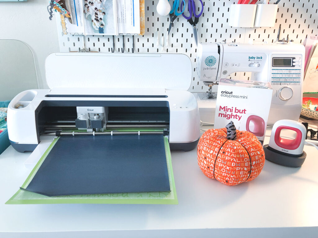 Cricut Maker, Easy Press Mini and fabric pumpkin are supplies needed to make Fabric Jack O lantern