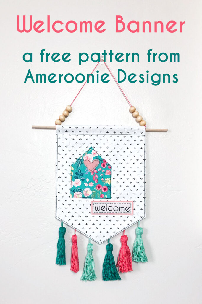 Welcome Wall Banner DIY featured by Top US sewing blog Ameroonie Designs: image of floral cottage on wall banner with embroidered welcome.
