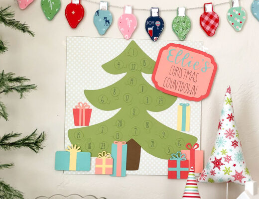 Personalized Christmas Countdown featured by top US craft blog Ameroonie Designs: image of paper Christmas Countdown and holiday decorations.