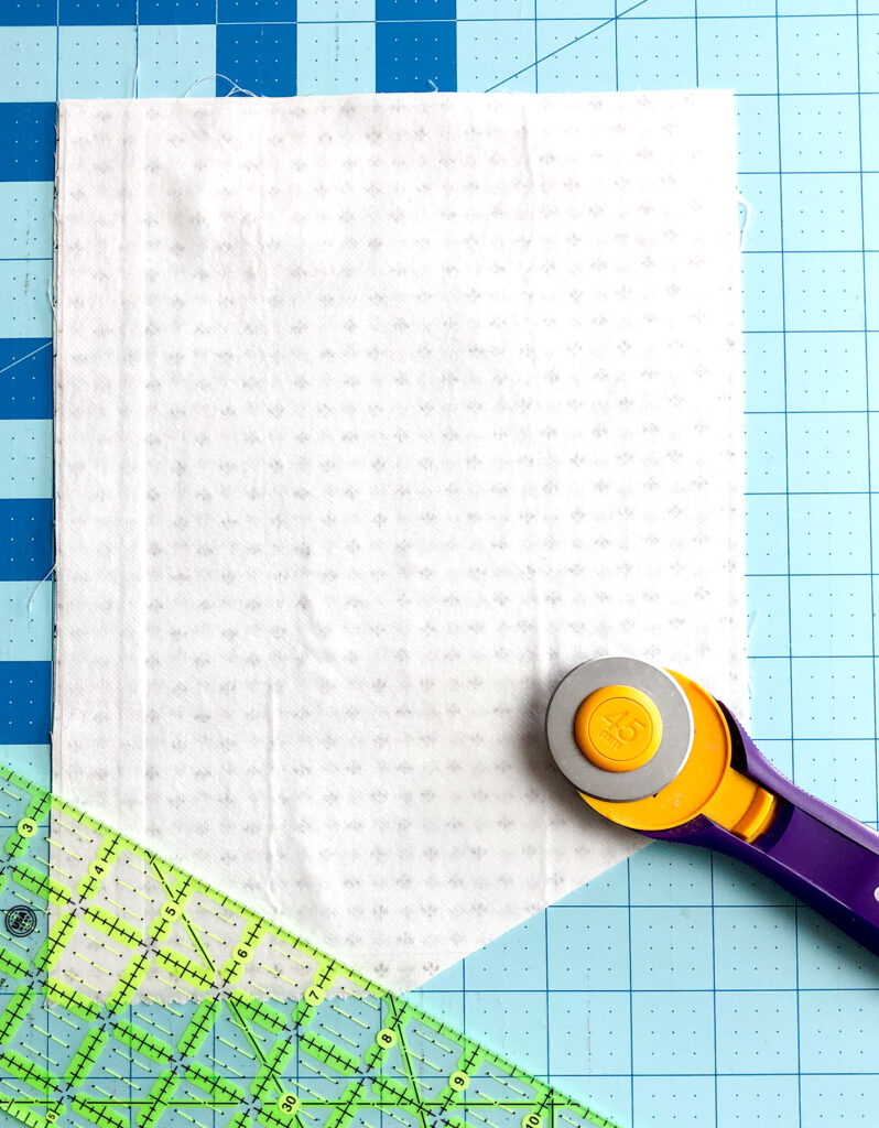 Welcome Wall Banner DIY featured by Top US sewing blog Ameroonie Designs: image shows how to create the point on the bottom of the banner.