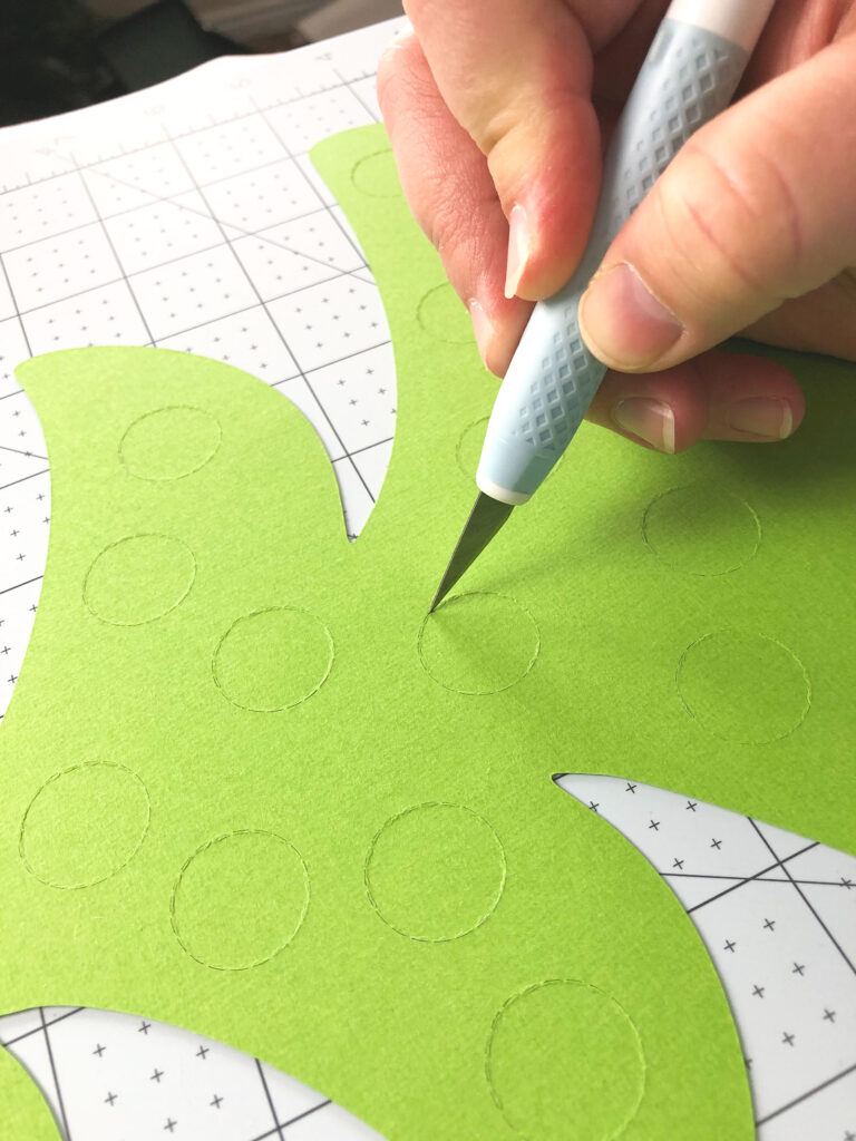 Personalized Christmas Countdown featured by top US craft blog Ameroonie Designs: image of cutting blade creating slit in perforated circle