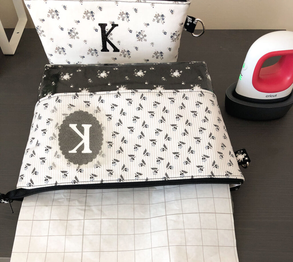 Personalized Zipper Pouch Tutorial featured by top US sewing blog Ameroonie Designs: Protect lining of pouch by inserting paper backing before fusing monogram.
