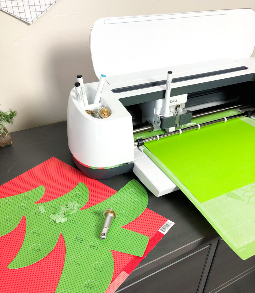 Personalized Christmas Countdown featured by top US craft blog Ameroonie Designs: image of Cricut Maker cutting out pattern pieces.