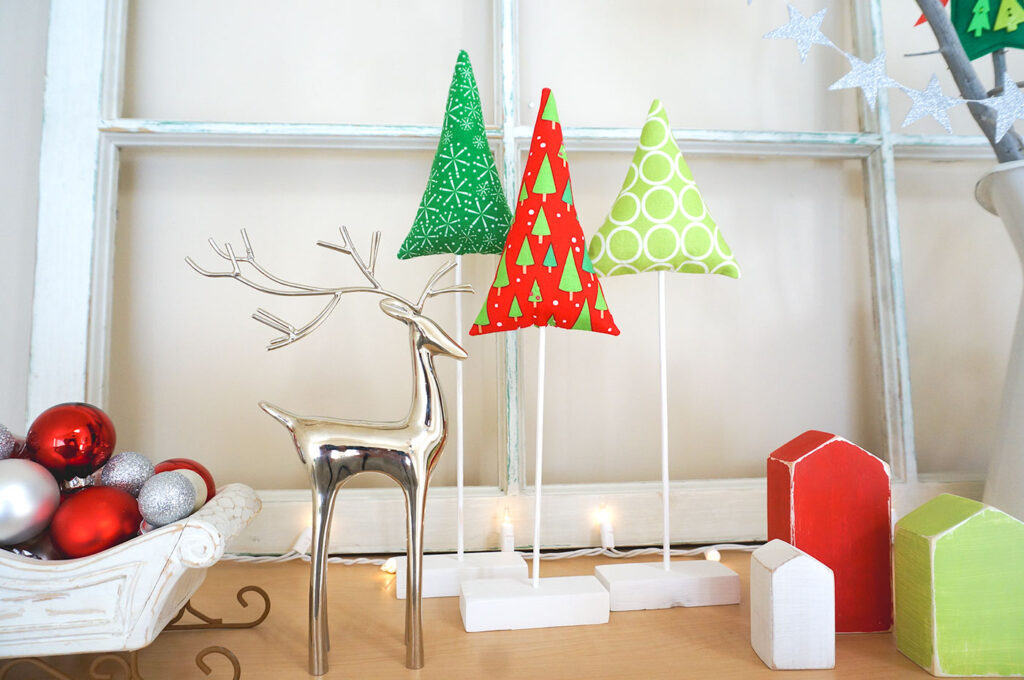 Fabric Tree tutorial by top US sewing blog Ameroonie Designs: Image of fabric trees in holiday setting.