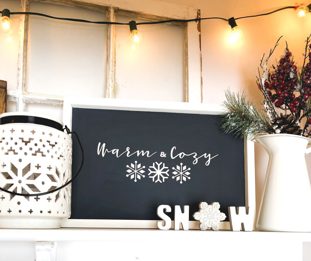 DIY Winter Decor Sign from top US craft blogger Ameroonie Designs: image of black and cream sign with phrase Warm and Cozy.