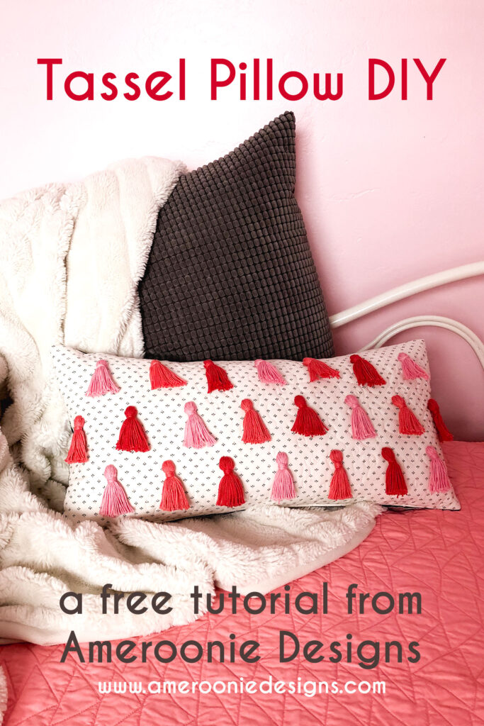 Tassel Pillow DIY featured by top US sewing blog Ameroonie Designs: image of Valentine's themed tassel pillow created from DIY instructions.