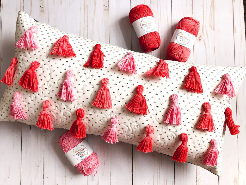 Tassel Pillow DIY featured by top US sewing blog Ameroonie Designs: Image of accent pillow with textured tassels.