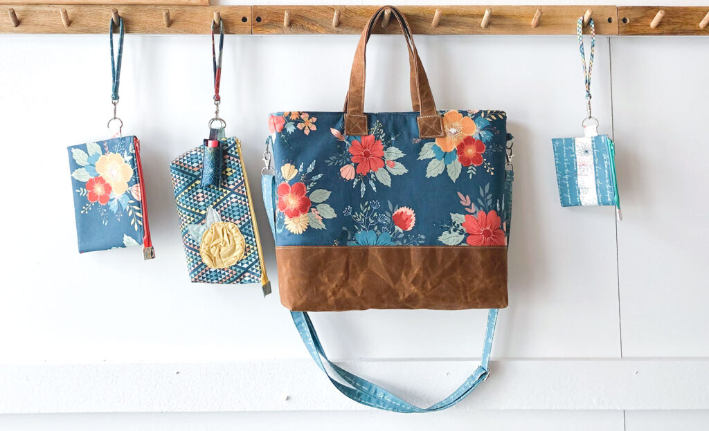 Best Zipper Pouches to sew for your purse featuring Top US sewing blog Ameroonie Designs: image of tote bag and zipper pouches hanging from peg rail