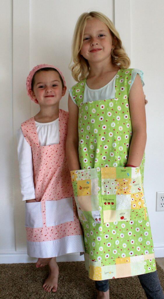 Crossback Apron Tutorial by Top US sewing blog Ameroonie Designs: Image of different sizes of Crossback Aprons.