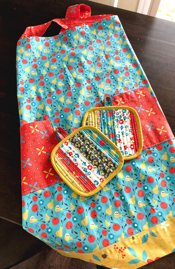 On The Bright Side fabric blog tour by top US sewing blog Ameroonie Designs. Image of: Apron and hot pads made with On the Bright Side fabric.