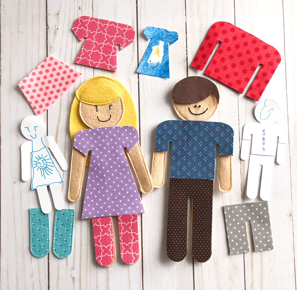 Amazing Cricut Projects to make at home by Top US craft blog Ameroonie Designs. Image of Paper and felt dolls made using Cricut Maker.