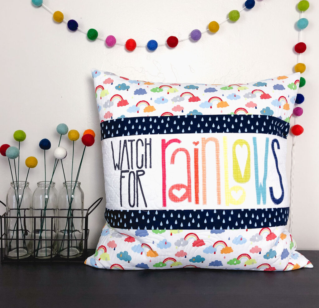Watch for Rainbows Pillow Tutorial by Top US sewing blog Ameroonie Designs. Image of: pillow with pom flowers and garland
