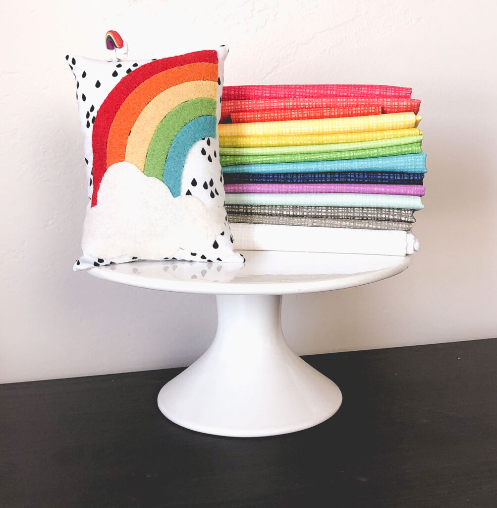 Texture Fabric Blog Tour by Top US sewing blog Ameroonie Designs: image of rainbow colored fabric and wool applique pincushion