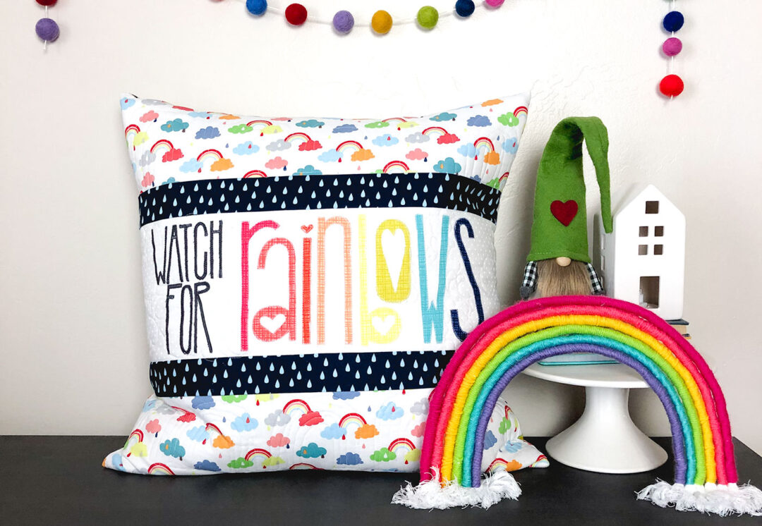 Watch for Rainbows Pillow tutorial by Top US sewing blog Ameroonie Designs: Image of quilted pillow with rainbow and garland