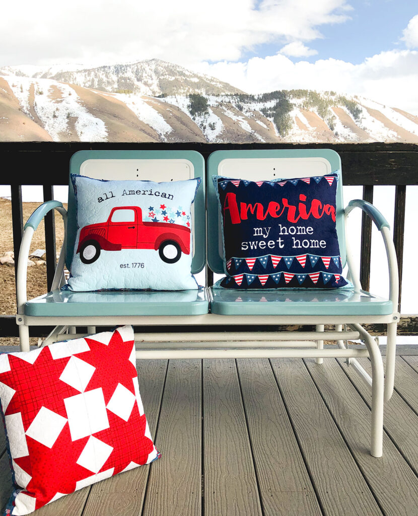 Patriotic Porch Pillow Tutorial by Top US sewing blog Ameroonie Designs. Image of: Fourth of July themed pillows with mountain background.