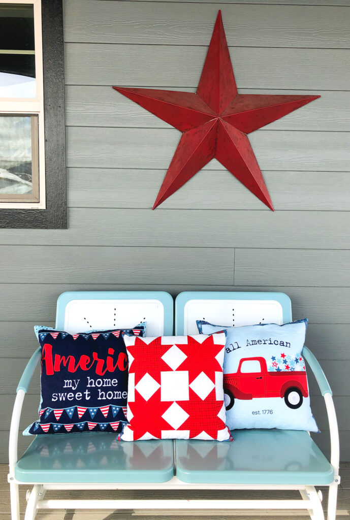 Patriotic Porch Pillow Tutorial by Top US sewing blog Ameroonie Designs. Image of: front porch with glider and patriotic pillows for decoration