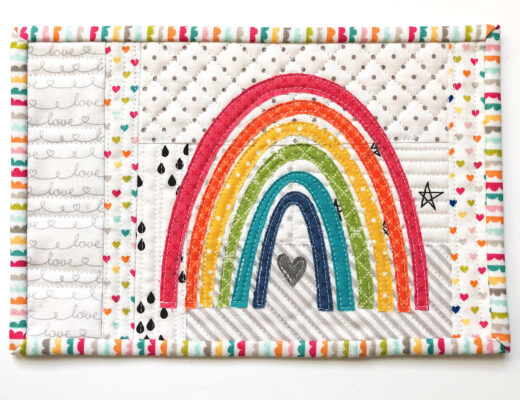 Mini Rainbow Applique Pattern by top US sewing blog Ameroonie Designs image of mug rug with rainbow applique