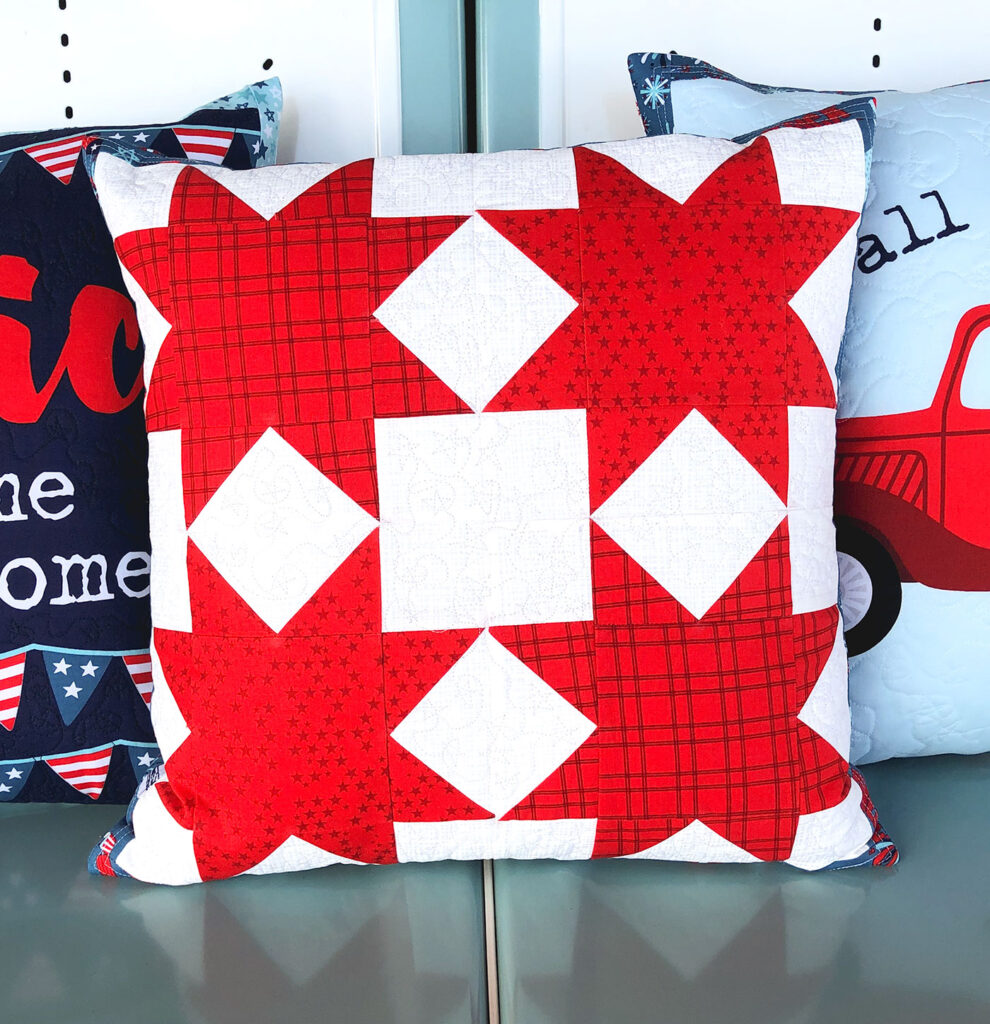Patriotic Porch Pillow Tutorial by Top US sewing blog Ameroonie Designs. Image of: star pillow using Sawtooth stars quilt block.