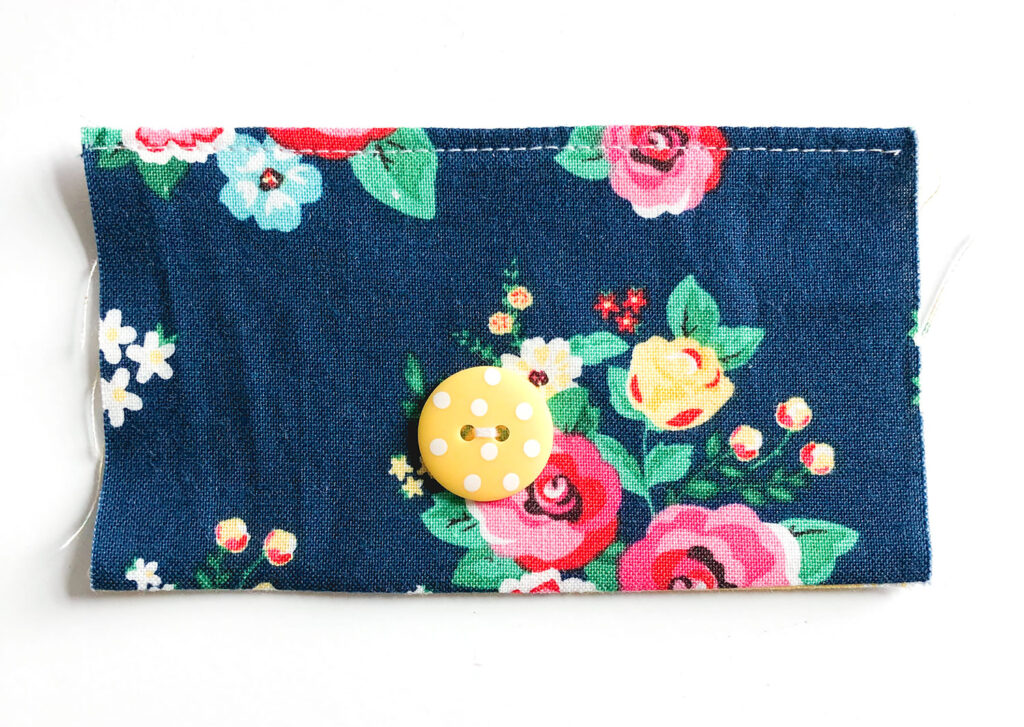 Mini Wallet Tutorial by Top US sewing blog Ameroonie Designs. Image of: attaching button to pocket for elastic closure.