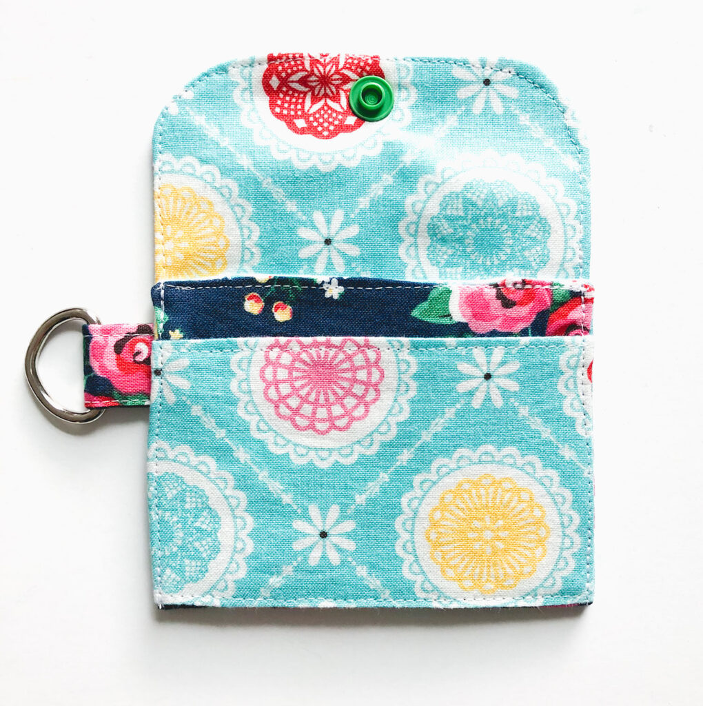 Mini Wallet Tutorial by Top US sewing blog Ameroonie Designs. Image of: adding snap closure to mini wallet.