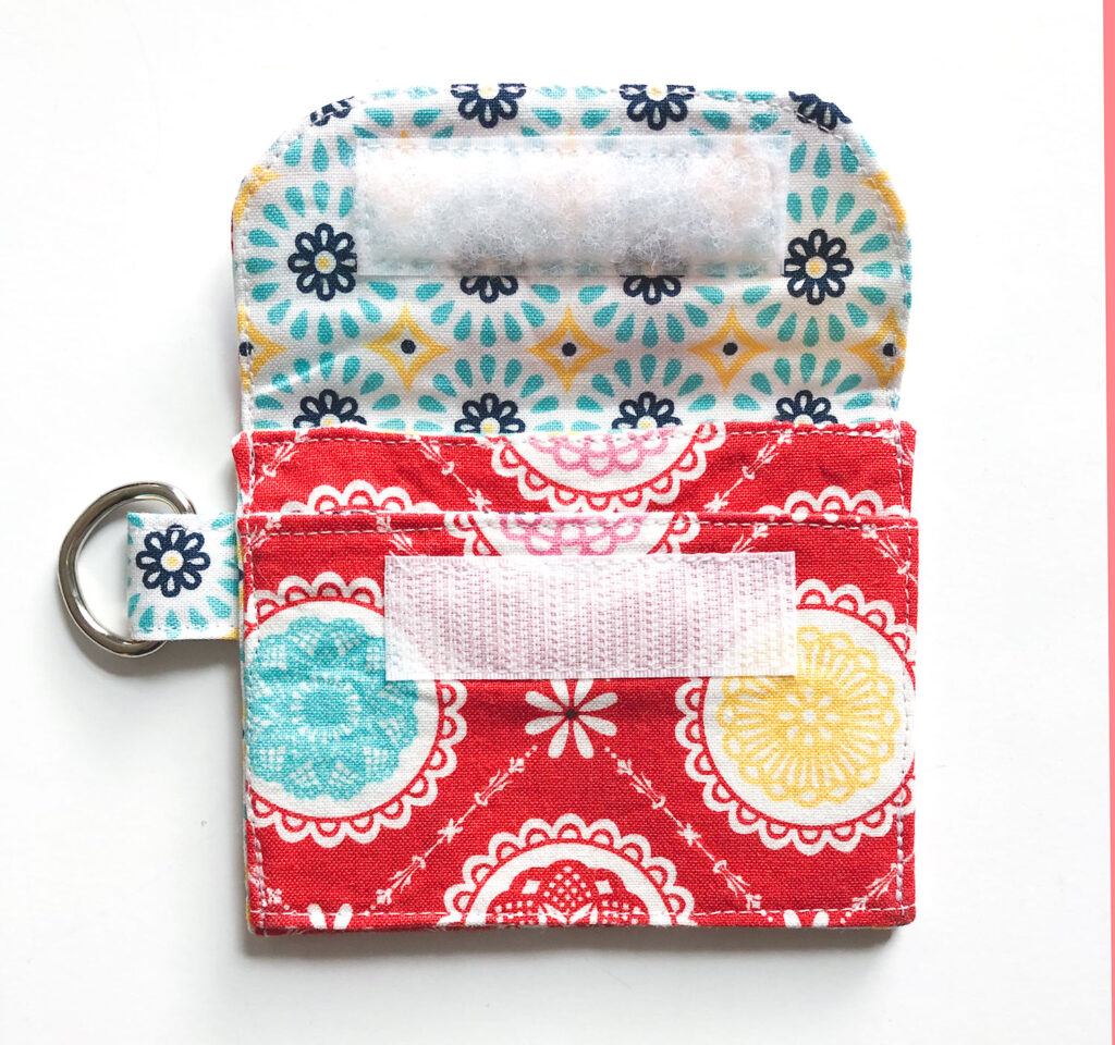 Mini Wallet Tutorial by Top US sewing blog Ameroonie Designs. Image of: folding up wallet pocket and top stitching.