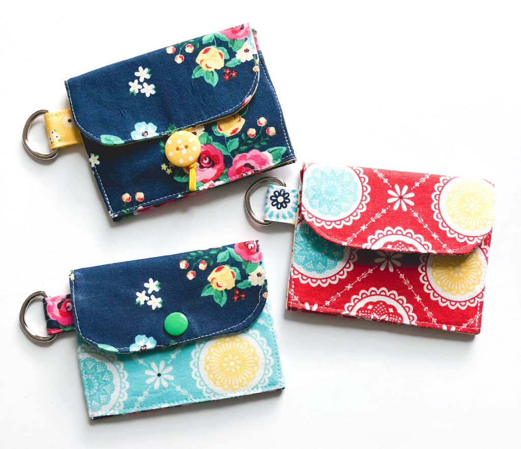 Mini Wallet Tutorial by Top US sewing blog Ameroonie Designs. Image of: three mini wallets with different closure styles.