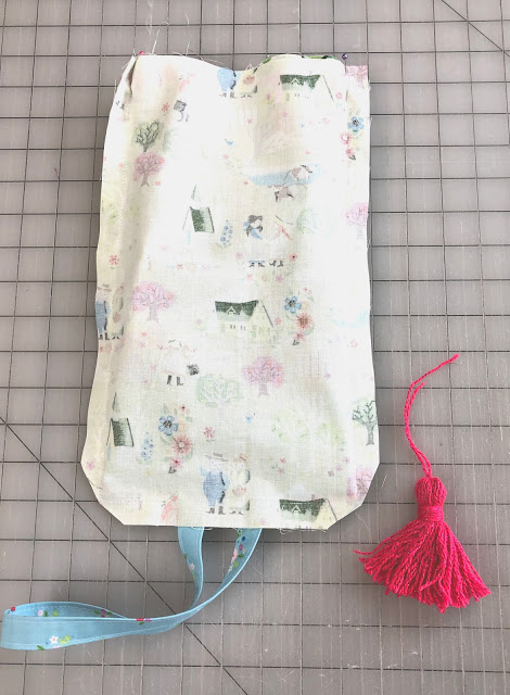 How to Sew a Small Sling Bag for Kids, a tutorial featured by top US sewing blog, Ameroonie Designs: add tassel embellishment if desired