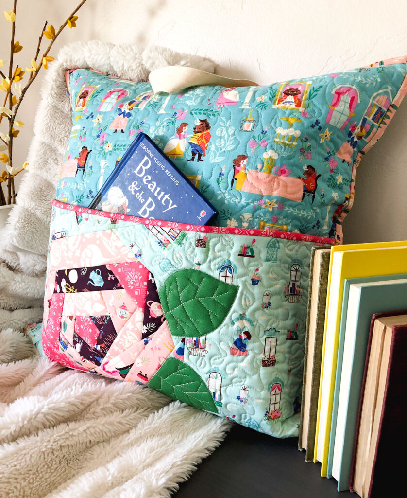 QAYG Rose Reading Pillow by top US sewing blog Ameroonie Designs. Image of: QAYG Rose reading pillow with pocket for books.
