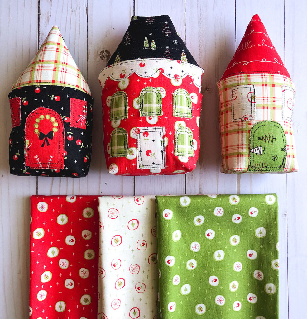 Fabric Christmas Village by Top US sewing blog Ameroonie Designs image of: stuffed fabric houses and prints from Merry Little Christmas fabric line.