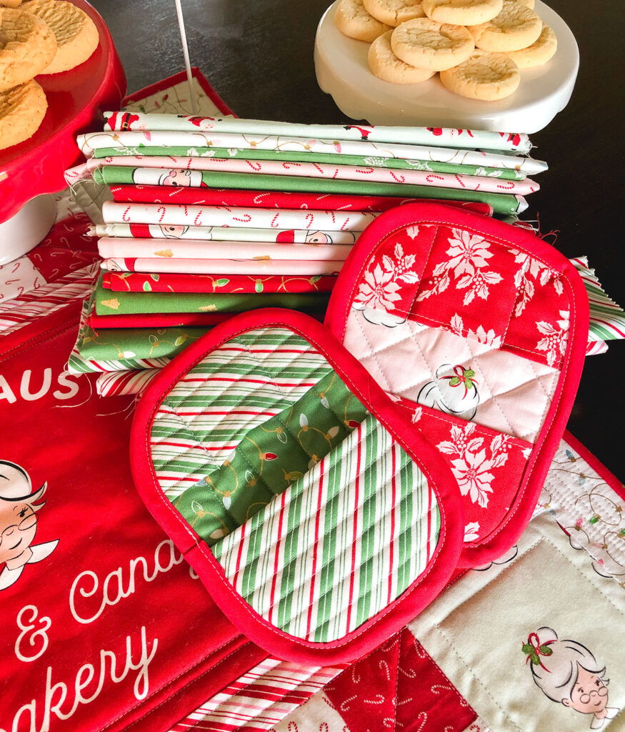 How to Sew a Hot Pad with Pockets by top US sewing blog Ameroonie Designs. Image of: hot pads, cookies and Santa Claus lane fabric.