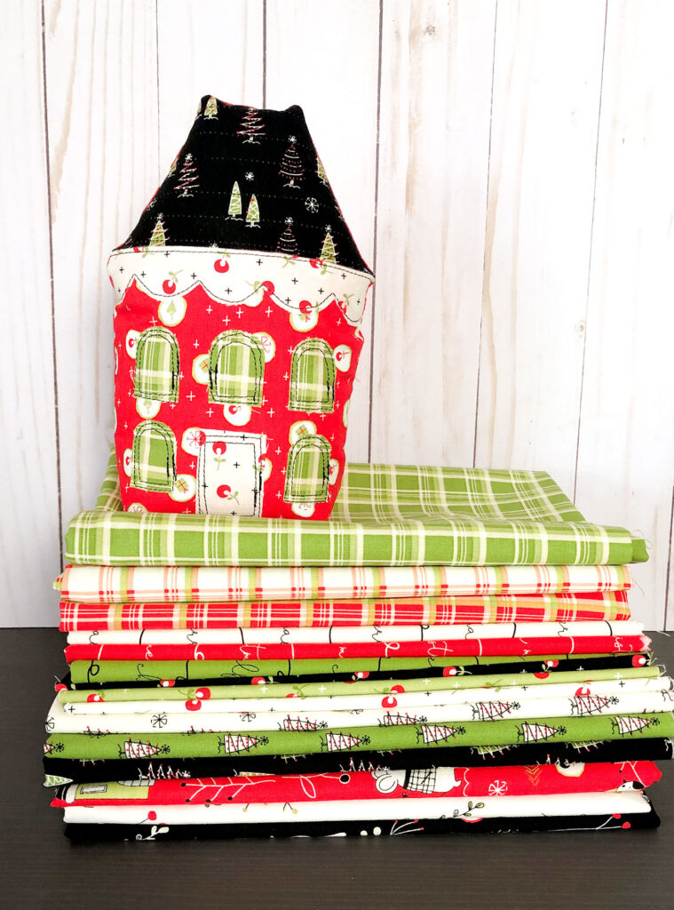 Fabric Christmas Village by Top US sewing blog Ameroonie Designs image of:prints in the Merry Little Christmas fabric line.