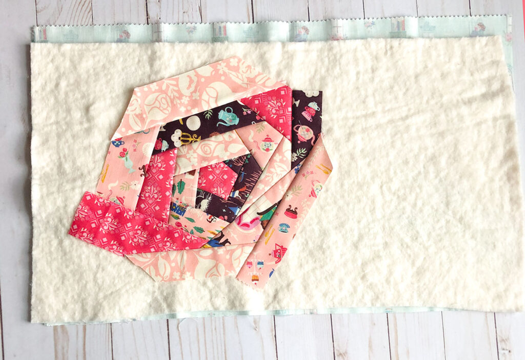 QAYG Rose Reading Pillow by top US sewing blog Ameroonie Designs. Image of: finishing the rose shape.