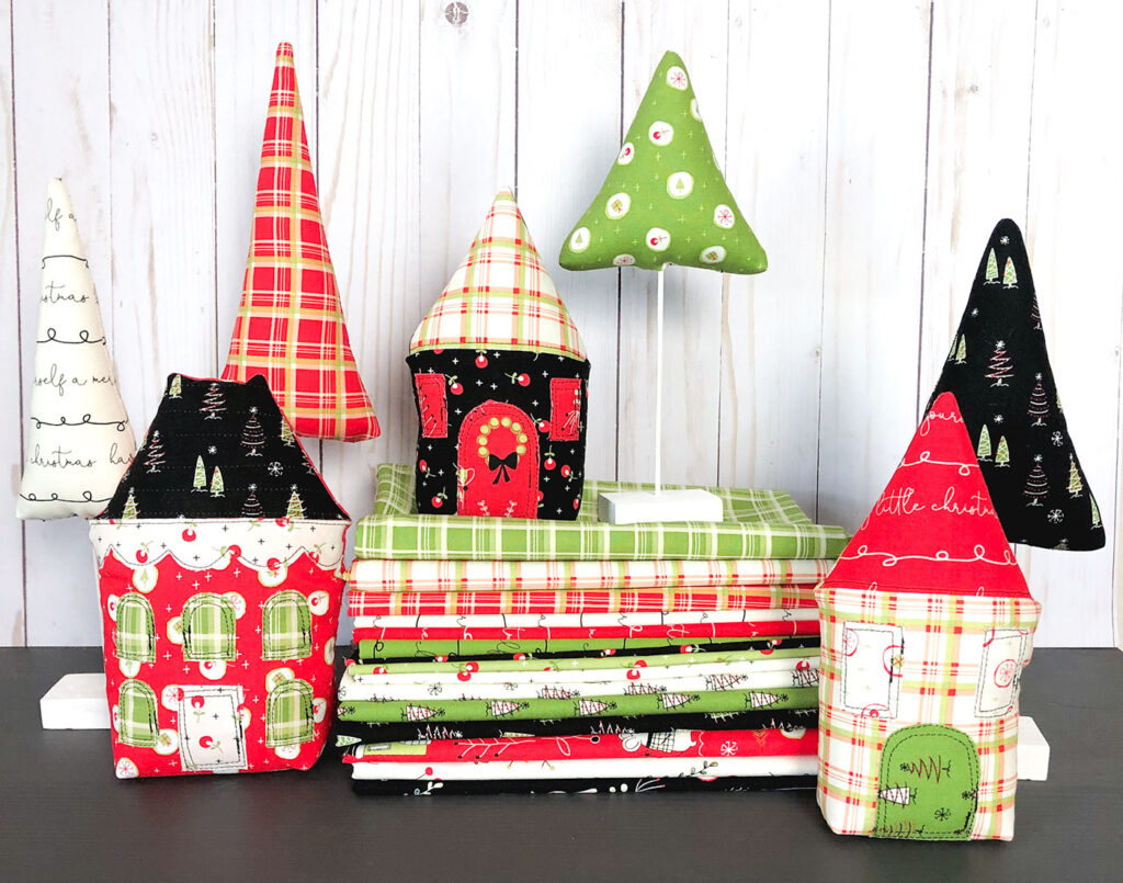 Fabric Christmas Village by Top US sewing blog Ameroonie Designs image of: Fabric houses and trees made with Merry Little Christmas fabric.