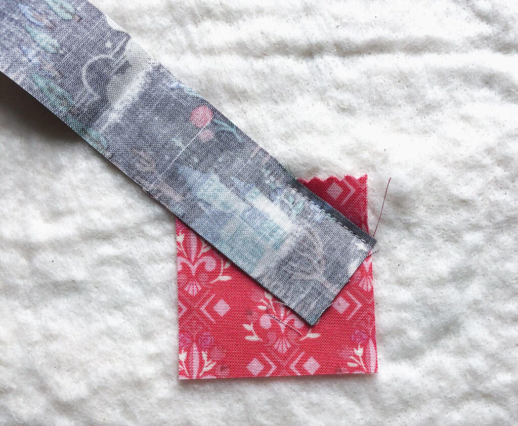 QAYG Rose Reading Pillow by top US sewing blog Ameroonie Designs. Image of: beginning the QAYG rose.