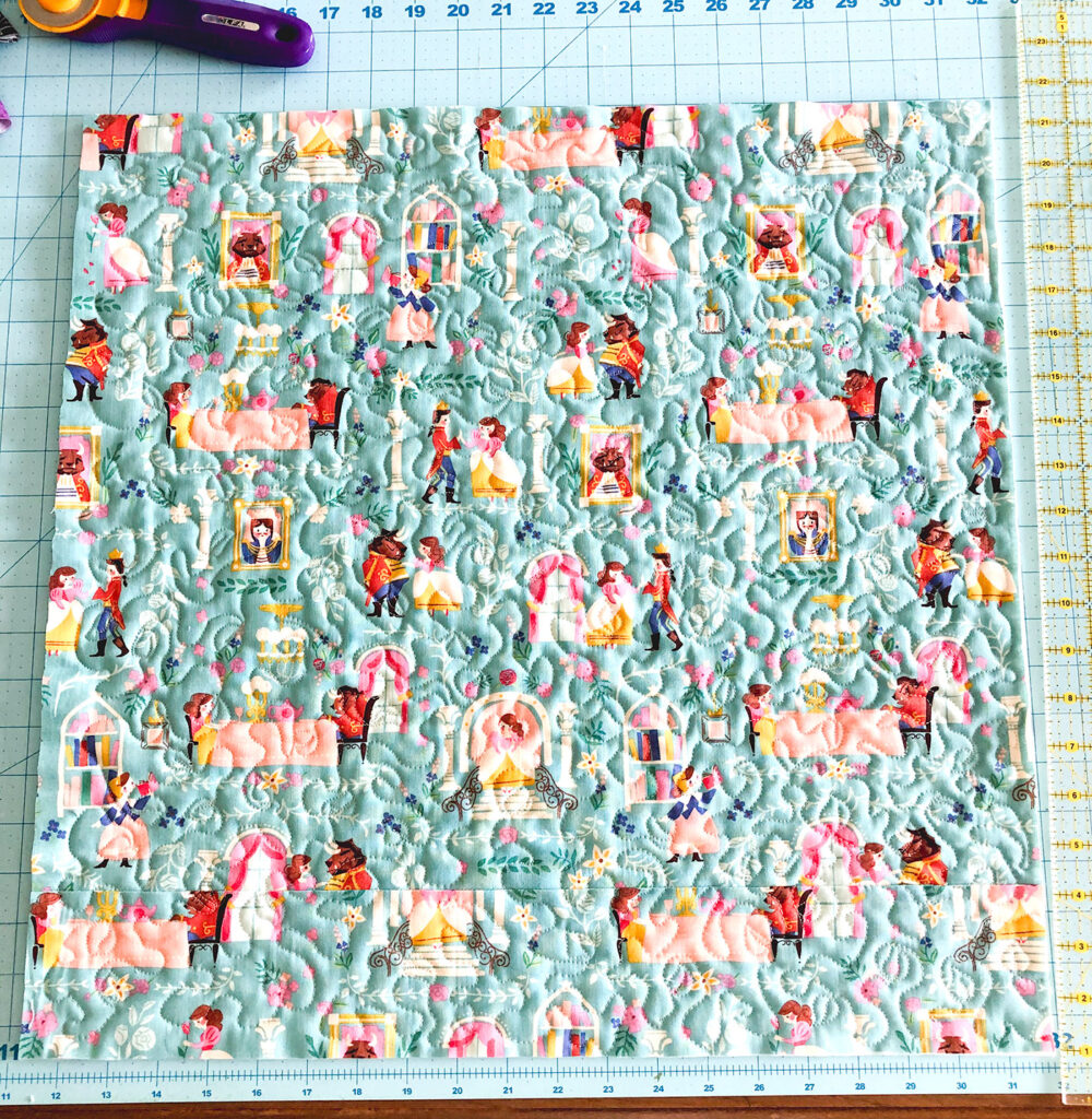 QAYG Rose Reading Pillow by top US sewing blog Ameroonie Designs. Image of: quilting the pillow front piece.
