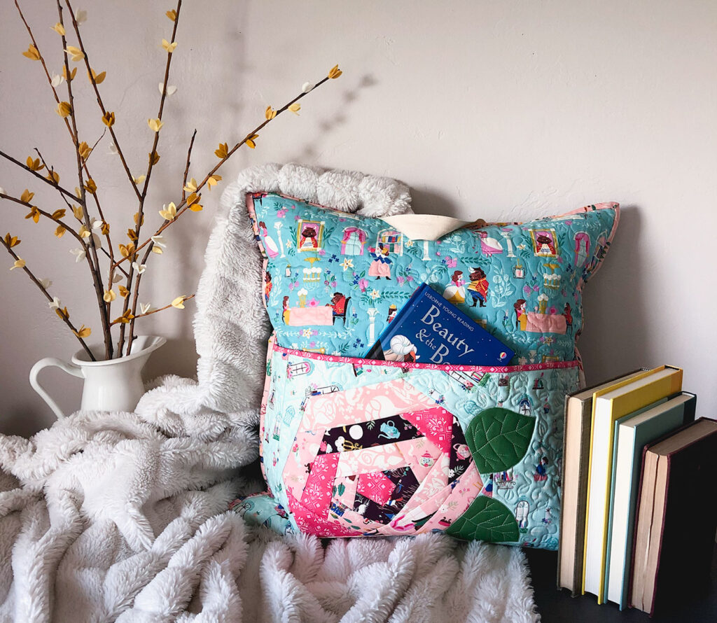 QAYG Rose Reading Pillow by top US sewing blog Ameroonie Designs. Image of: reading pillow with blanket and books.