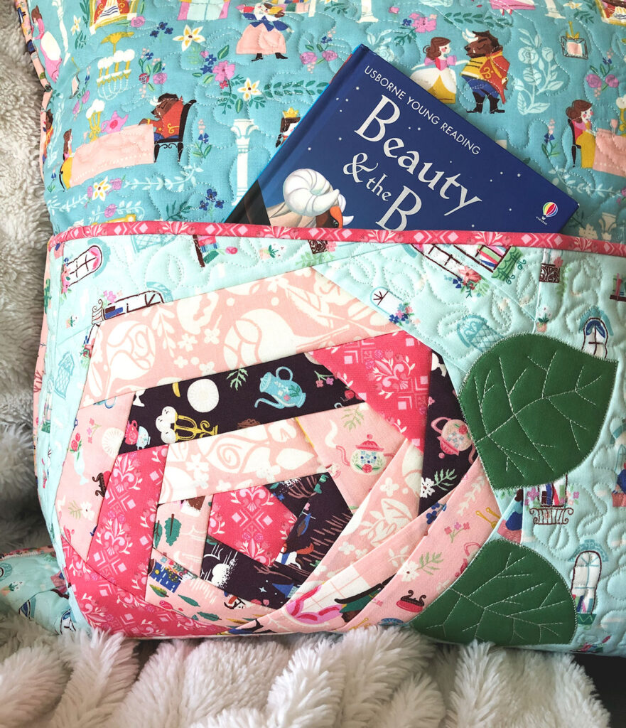QAYG Rose Reading Pillow by top US sewing blog Ameroonie Designs. Image of: close up of quilt as you go rose.