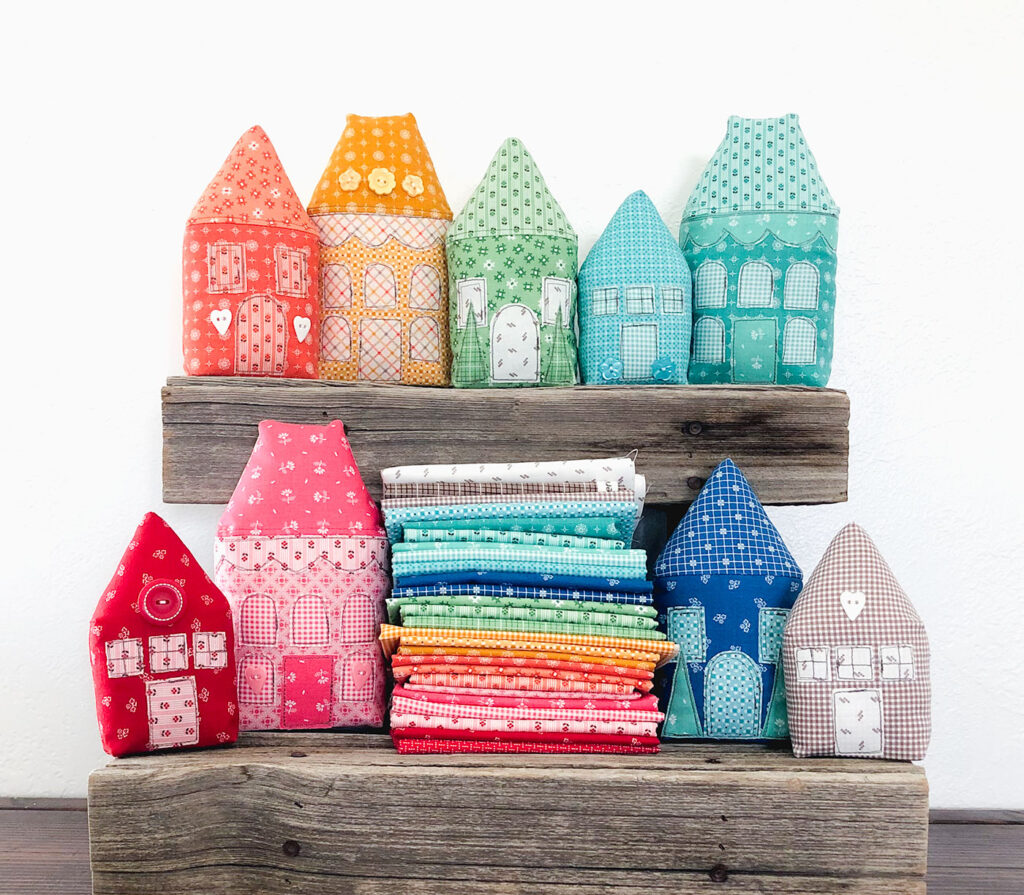 Rainbow Village with Prim fabric by Top US sewing blog Ameroonie Designs: image of stuffed fabric houses.