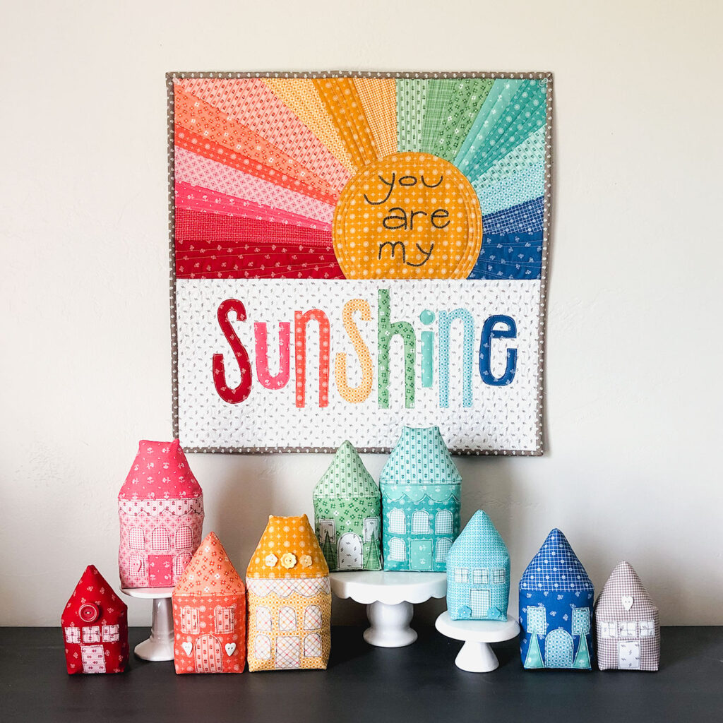 Rainbow Village with Prim fabric by Top US sewing blog Ameroonie Designs: image of Rainbow Village and Rainbow Sunshine mini quilt.