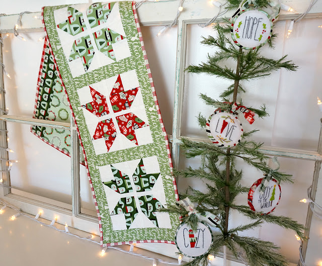 Snowflake table runner with Free Pattern, a tutorial featured by top US sewing blog, Ameroonie Designs: Joyful Snowflake table runner is sewn using Comfort and Joy fabric from Riley Blake