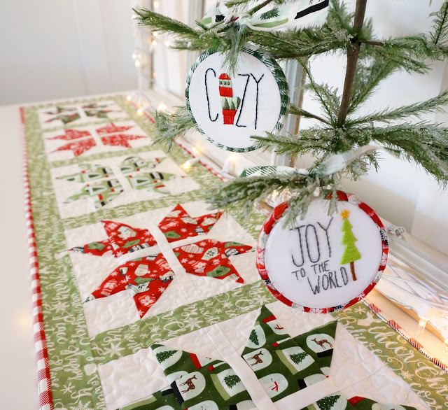Snowflake table runner with Free Pattern, a tutorial featured by top US sewing blog, Ameroonie Designs: The joyful snowflake table runner is shown with coordinating embroidered ornaments