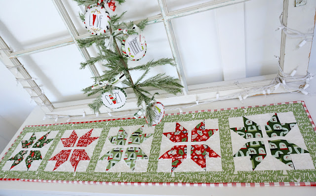 Snowflake table runner with Free Pattern, a tutorial featured by top US sewing blog, Ameroonie Designs: use Comfort and Joy fabric from Riley Blake Designs to create a holiday table runner