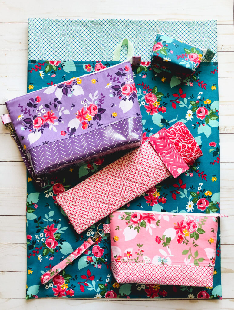 Handmade travel accessories from top US sewing blog Ameroonie Designs. Image of laundry bag, pouches and curling iron sleeve.