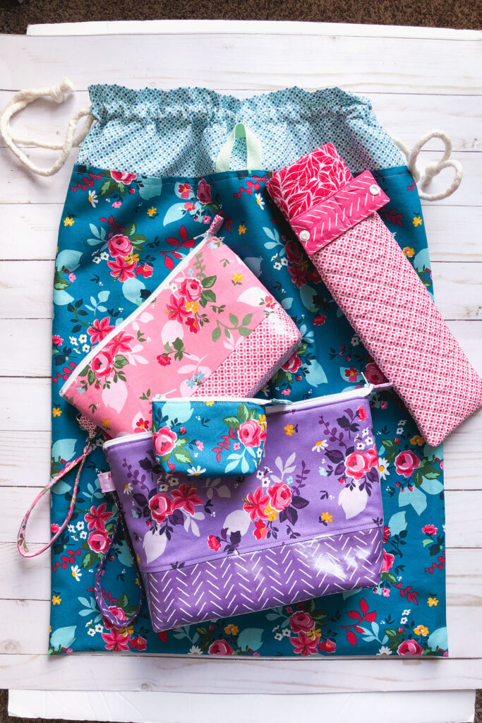Handmade travel accessories from top US sewing blog Ameroonie Designs. Image of travel pouches and bags using Fleur fabric.